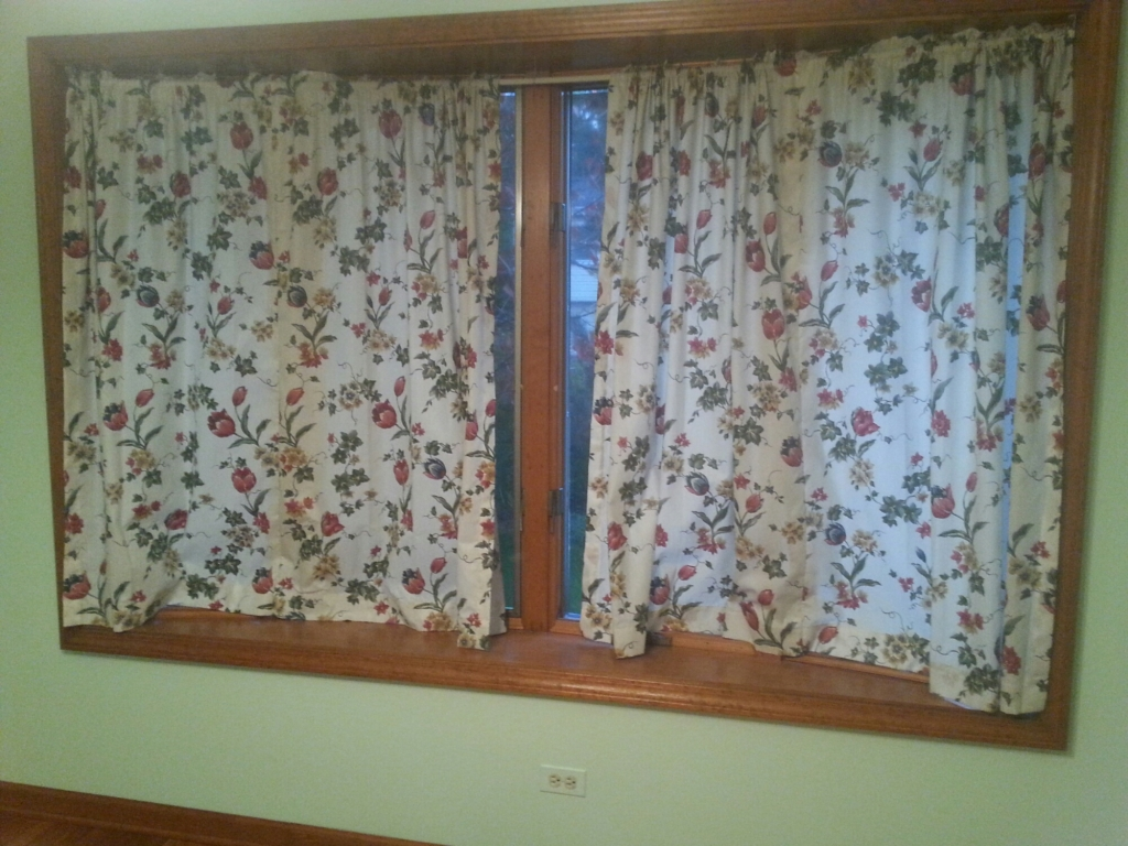Even the curtains, while not really my style at all, are helpful...even if they are getting replaced asap. (By the way, feel free to note the paint color. Next to it is a blue family room and what was a salmon kitchen. Hence the weekend painting.)