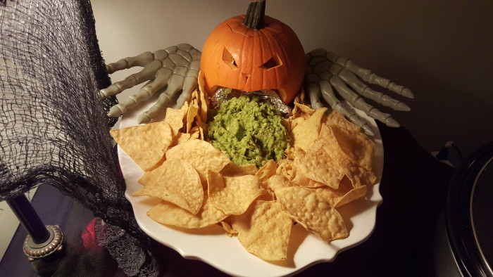 This puking pumpkin is always the hit of the party. I made homemade guac, carved a pie pumpkin, and surrounded it with chips