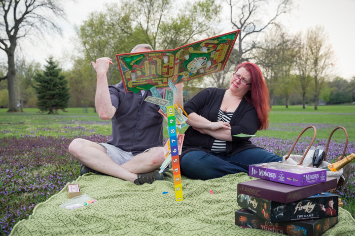 engagement photo shoot with the game of life throwing the game in the air