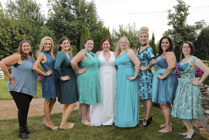 Standing with my something blue crew, all wearing teal dresses