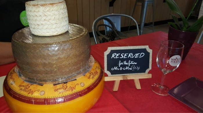 Our wedding cake was three tiered cheese wheels. This was the demo from Whole Foods.