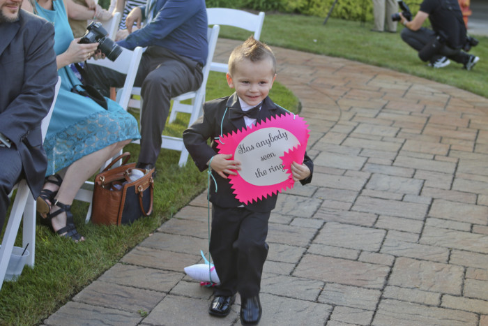 "Our ring bearer had a sign that said ""Has anybody seen the rings?"" and dragged the ring pillow behind him."