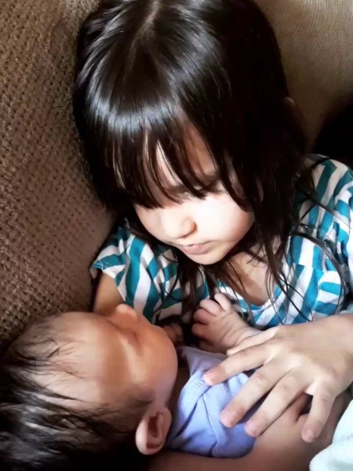 Child holding her infant cousin