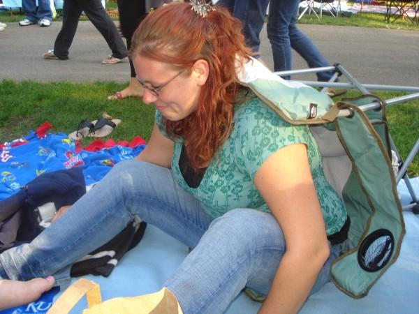 Chrissy falling out of her camp chair at the Backstreet Boys concert