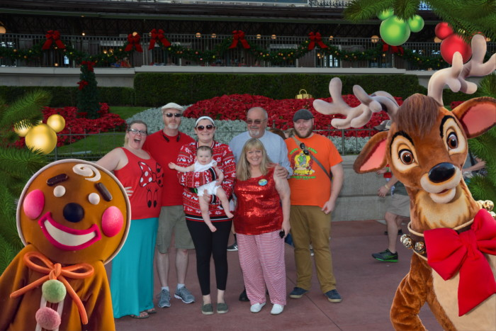 Family in front of Magic Kingdom Entrance with Magic Shot