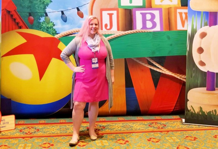 Chrissy disneybounding as Mrs. Hopps in front of Toy Story Land display at Disney Social Media Moms On the Road Conference