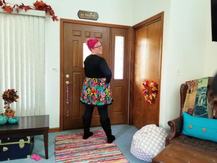 chrissy wearing a Marvel dress for jury duty