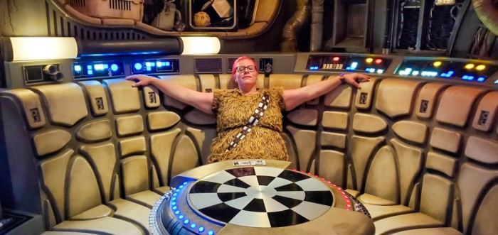 Wearing a Chewbacca dress waiting to ride the Millenium Falcon