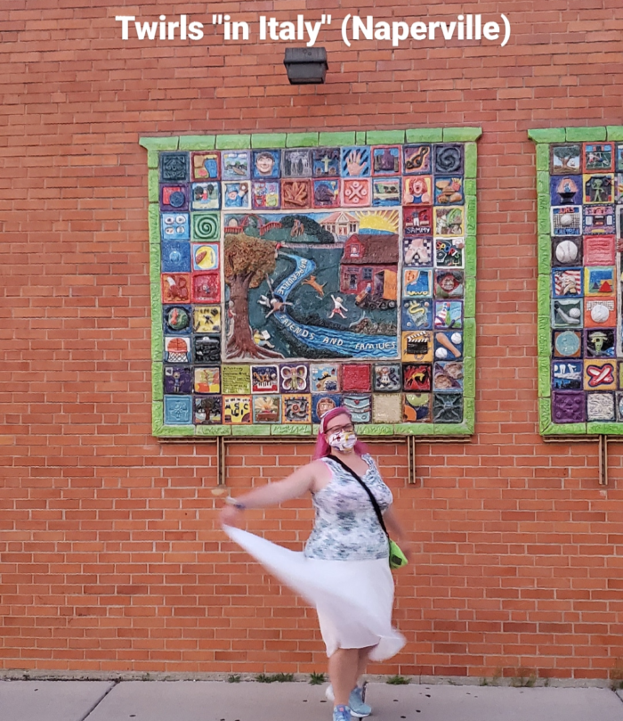 "Chrissy twirling in front of a mural in downtown Naperville with the caption ""twirls in 'Italy' (Naperville)"""