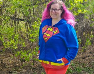 Chrissy posing in a Superman hoodie